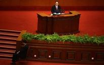 China widens anti-corruption drive to officials with family abroad