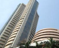 Sensex closes at record levels amid muted celebrations