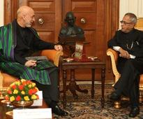 Pranab promises all help to Karzai