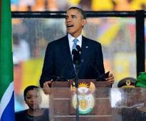 Obama, hailing Mandela, chides other leaders who stifle dissent