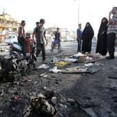 Bomb attack on bus kills 52 prisoners, 9 policemen in Baghdad