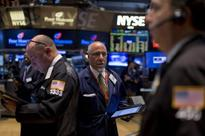 Wall St. turns negative as oil rally fades, tech stocks drag