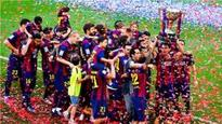 Xavi lifts trophy for Barcelona in league farewell