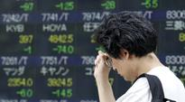 Asian stocks subdued, dollar hovers near 9 month high