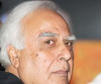 She fled with my money, says Sibal; Joshi hits back