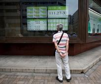 Asian shares edge up on Wall Street lead, pre-Fed nerves limit gains