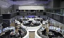 Global stocks bounce after U.S. debate; oil falls