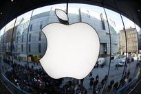 Apple expands buybacks by $30 billion