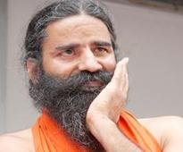 Ramdev tries to hush BJP nominee talking funds, microphone gives him away