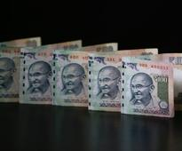 Rupee gains 4 paise on increased dollar selling