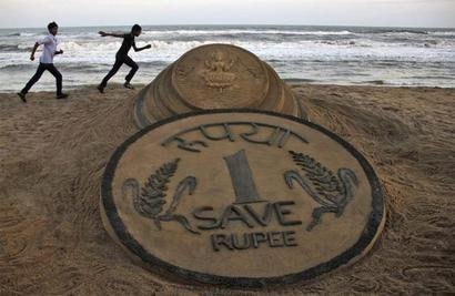 Rupee at 29-month low, sinks 7 paise vs dollar in early trade