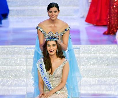 Miss World not upset over Tharoor's quip