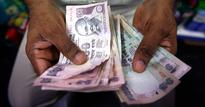 Rupee closes lower on dollar demand from importers