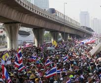 Protesters swarm in Thai capital to demand PM resigns
