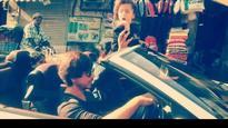 Watch Video: Little munchkin AbRam Khan enjoys a long drive with papa Shah Rukh Khan!