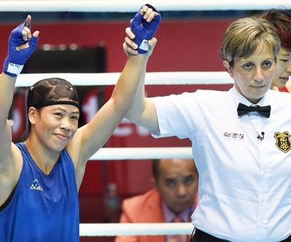 Asiad: Mary Kom punches her way into final; Sarita, Pooja settle for bronze