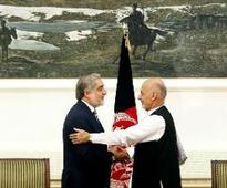 Afghan presidential candidates agree to share power, sign unity deal