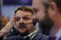 Wall Street dips; Dow poised to break 10-day record run