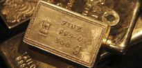 Gold Struggles Near Four-Month Lows on Robust Dollar
