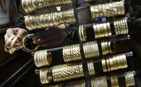 Gold up for third day on softer dollar; US rate hike pressure looms