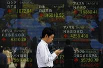 Asia shares rise on brightening U.S. prospects, BOJ awaited