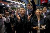 Global shares end flat, closing out strong week