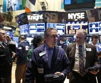Wall St slips on Fed stimulus uncertainty; P&G jumps