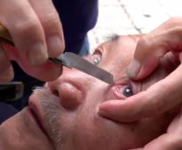 This Eyeball Shaving Barber Is Too Cutting-Edge For Us
