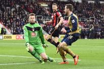Arsenal back in race with win at Bournemouth