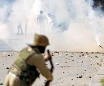 One dead as police firing at protesters in J&K