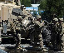 Two dead, nearly 60 wounded in Taliban attacks on police headquarters, military convoy in Kabul