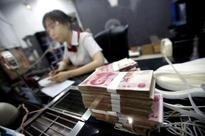 China says to accelerate reforms to support yuan in IMF currency basket - Xinhua