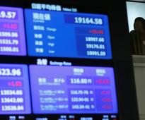 Asian shares firm, dollar slumps on ECB's tapering signal