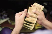 Rupee strengthens against US dollar to 64.83