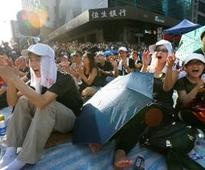 Quit or we occupy buildings, protesters tell Hong Kong leader