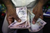 Rupee steady; stocks watched for clues
