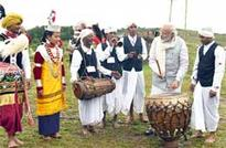 Modi plays drums and cymbals