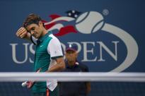 Federer eases into second round; others toil in heat