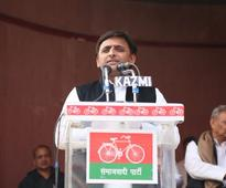 Akhilesh releases SP manifesto; father, uncle conspicuous by their absence