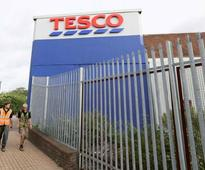 Tesco cuts profit outlook again and suspends staff after accounting error