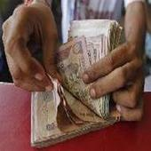FIIs' equity investments cross Rs 1-lakh crore mark in 2013