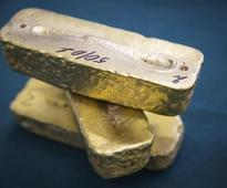 Gold rises above $1,200, but robust dollar curbs gains