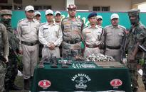 UGs held, huge cache of arms seized