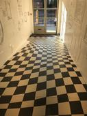 Company Uses Optical Illusion Floor Tiles to Prevent People Running Through Its Hallway