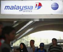 Malaysia probing two more passengers on missing flight: source