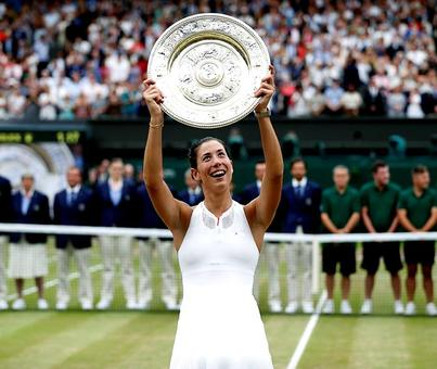 Wimbledon champion Muguruza eyes more trophies not rankings