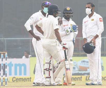 Sri Lanka go behind masks after Kohli's record double