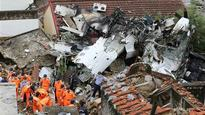 Relatives Fly to Taiwan Plane Crash Site, 48 Dead