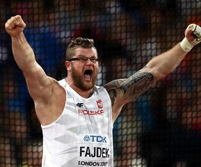 World Athletics PHOTOS: Golden hat-trick for Poland's Fajdek