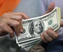 Dollar subdued in post-holiday trade, euro under pressure